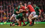 16 March 2019; Gareth Anscombe of Wales is tackled by Rob Kearney, left, and Keith Earls of Ireland during the Guinness Six Nations Rugby Championship match between Wales and Ireland at the Principality Stadium in Cardiff, Wales. Photo by Ramsey Cardy/Sportsfile