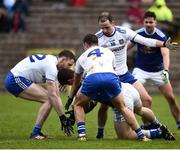 16 March 2019; James Smith of Cavan in action against Owen Duffy, Ryan Wylie and Conor Boyle of Monaghan  during the Allianz Football League Division 1 Round 6 match between Monaghan and Cavan at St Tiernach's Park in Clones, Monaghan. Photo by Oliver McVeigh/Sportsfile