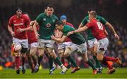 16 March 2019; Jonathan Sexton of Ireland attempts to gain possession against Gareth Anscombe, 10, of Wales during the Guinness Six Nations Rugby Championship match between Wales and Ireland at the Principality Stadium in Cardiff, Wales. Photo by Brendan Moran/Sportsfile