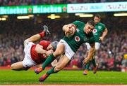 16 March 2019; Jordan Larmour of Ireland scores his side's last minute try despite the tackle of Owen Watkin of Wales during the Guinness Six Nations Rugby Championship match between Wales and Ireland at the Principality Stadium in Cardiff, Wales. Photo by Brendan Moran/Sportsfile
