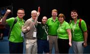 16 March 2019; Team Ireland's Francis Power, a member of Navan Arch Club, from Navan, Co. Meath, with Paul Ahern, left, Chief Executive of Sport Ireland John Treacy, Gary Desmond, CEO Gala Retail, Jo McDaid, and Annmarie Sweeney, right, after his 3-2 win in the Table Tennis matches on Day Two of the 2019 Special Olympics World Games in the Abu Dhabi National Exhibition Centre, Abu Dhabi, United Arab Emirates. Photo by Ray McManus/Sportsfile
