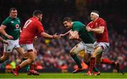16 March 2019; Jonathan Sexton of Ireland is tackled by Nicky Smith, left, and Hadleigh Parkes of Wales during the Guinness Six Nations Rugby Championship match between Wales and Ireland at the Principality Stadium in Cardiff, Wales. Photo by Ramsey Cardy/Sportsfile
