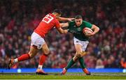 16 March 2019; Jordan Larmour of Ireland is tackled by Owen Watkin of Wales during the Guinness Six Nations Rugby Championship match between Wales and Ireland at the Principality Stadium in Cardiff, Wales. Photo by Ramsey Cardy/Sportsfile