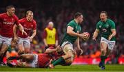 16 March 2019; Jack Conan of Ireland offloads to team-mate Kieran Marmion as he is tackled by Josh Navidi of Wales during the Guinness Six Nations Rugby Championship match between Wales and Ireland at the Principality Stadium in Cardiff, Wales. Photo by Brendan Moran/Sportsfile