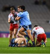 16 March 2019; Niall Sludden of Tyrone is confronted by Cian O'Connor and Cian O'Sullivan, right, of Dublin as he tries to pull Brian Fenton to his feet during the Allianz Football League Division 1 Round 6 match between Dublin and Tyrone at Croke Park in Dublin. Photo by David Fitzgerald/Sportsfile