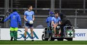 16 March 2019; Paddy Andrews of Dublin leaves the field on a medical buggy as team-mate Dean Rock prepares to take a free kick during the Allianz Football League Division 1 Round 6 match between Dublin and Tyrone at Croke Park in Dublin. Photo by Piaras Ó Mídheach/Sportsfile