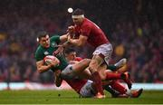 16 March 2019; Garry Ringrose of Ireland is tackled by Josh Adams, left, and Dan Biggar of Wales during the Guinness Six Nations Rugby Championship match between Wales and Ireland at the Principality Stadium in Cardiff, Wales. Photo by Ramsey Cardy/Sportsfile
