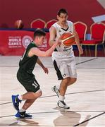 17 March 2019; Team Ireland's Stephen Murphy, a member of the Palmerstown Wildcats Special Olympics Club, from Lucan, Co. Dublin, in action against Antoine Jamin of France in the Basketball game on Day Three of the 2019 Special Olympics World Games in the Abu Dhabi National Exhibition Centre, Abu Dhabi, United Arab Emirates. Photo by Ray McManus/Sportsfile