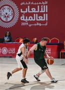 17 March 2019; Team Ireland's Keith Murphy, a member of the Palmerstown Wildcats Special Olympics Club, from Ballybritas, Co. Laois, races clear of Arthur Gondard of France in the SO Ireland v SO France Basketball game on Day Three of the 2019 Special Olympics World Games in the Abu Dhabi National Exhibition Centre, Abu Dhabi, United Arab Emirates. Photo by Ray McManus/Sportsfile
