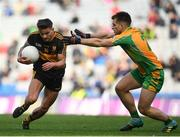 17 March 2019; Micheál Burns of Dr. Crokes' in action against Cathal Silke of Corofin during the AIB GAA Football All-Ireland Senior Club Championship Final match between Corofin and Dr Crokes at Croke Park in Dublin. Photo by Harry Murphy/Sportsfile
