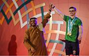 17 March 2019; Team Ireland's Patrick Quinlivan, a member of the Salto SOC from Letterkenny, Co. Donegal, is congratulated after being presented with the 4th of his 7 medals for Artistic Gymnastics from H.H. Abdulla Bin Mohomed Al Hamed on Day Three of the 2019 Special Olympics World Games in the Abu Dhabi National Exhibition Centre, Abu Dhabi, United Arab Emirates. Photo by Ray McManus/Sportsfile