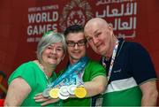 17 March 2019; Team Ireland's Patrick Quinlivan, a member of the Salto SOC from Letterkenny, Co. Donegal, who won seven medals, two Gold and five Silver, for Artistic Gymnastics with his parents Angela McGee and Mick Quinlivan on Day Three of the 2019 Special Olympics World Games in the Abu Dhabi National Exhibition Centre, Abu Dhabi, United Arab Emirates. Photo by Ray McManus/Sportsfile