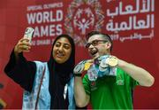17 March 2019; Team Ireland's Patrick Quinlivan, a member of the Salto SOC from Letterkenny, Co. Donegal, who won seven medals, two Gold and five Silver, for Artistic Gymnastics poses with a local volunteer for a 'selfie' on Day Three of the 2019 Special Olympics World Games in the Abu Dhabi National Exhibition Centre, Abu Dhabi, United Arab Emirates. Photo by Ray McManus/Sportsfile