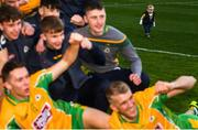 17 March 2019; Liam Comer, aged 1, son of Corofin selector Dave Comer watches the team celebrate following the AIB GAA Football All-Ireland Senior Club Championship Final match between Corofin and Dr Crokes at Croke Park in Dublin. Photo by Harry Murphy/Sportsfile