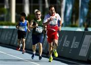 18 March 2019; Team Ireland's Alan Power, 472, a member of the South Dublin Special Olympics Sports Club, from Dublin 16, Co. Dublin, trails Germany's Thorsten Faulstich, who won Silver, on his way to win a Bronze medal, in the 5,000m race on Day Four of the 2019 Special Olympics World Games in the Dubai Police Officer's Club Stadium, Dubai, United Arab Emirates.  Photo by Ray McManus/Sportsfile