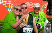 18 March 2019; Rosaleen and Joe Power with their son Team Ireland's Alan Power, a member of the South Dublin Special Olympics Sports Club, from Wood Town, Knocklyon, Co Dublin, after he won a Bronze medal, in the 5,000m race on Day Four of the 2019 Special Olympics World Games in the Dubai Police Officer's Club Stadium, Dubai, United Arab Emirates.  Photo by Ray McManus/Sportsfile