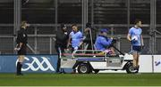 16 March 2019; Paddy Andrews of Dublin is helped on to a medical buggy, after his jaw was broken in a challenge from Tyrone goalkeeper Niall Morgan, during the Allianz Football League Division 1 Round 6 match between Dublin and Tyrone at Croke Park in Dublin. Photo by Piaras Ó Mídheach/Sportsfile