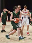 19 March 2019; Team Ireland's Jamie Ennis, a member of the Palmerstown Wildcats Special Olympics Club, from Dublin 22, Co. Dublin, in action against Terry Stebler of SO Switzerland during the Male / Mixed Playoff Round 1 Basketball game on Day Five of the 2019 Special Olympics World Games in the Abu Dhabi National Exhibition Centre, Abu Dhabi, United Arab Emirates. Photo by Ray McManus/Sportsfile