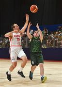 19 March 2019; Team Ireland's Jamie Ennis, a member of the Palmerstown Wildcats Special Olympics Club, from Dublin 22, Co. Dublin, in action against Nicolas Zurbruegg of  SO Switzerland during the Male / Mixed Playoff Round 1 Basketball game on Day Five of the 2019 Special Olympics World Games in the Abu Dhabi National Exhibition Centre, Abu Dhabi, United Arab Emirates. Photo by Ray McManus/Sportsfile