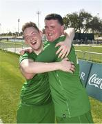 19 March 2019; Team Ireland's James Hunter, left, a member of Mallow Utd, from Mallow, Co. Cork, and Team Ireland's William McGrath, a member of Waterford SO Clubs, from Kilmacthomas, Co. Waterford, celebrate after beating SO Estonia 7-2  to take the Bronze medal place on Day Five of the 2019 Special Olympics World Games in Zayed Sports City, Airport Road, Abu Dhabi, United Arab Emirates. Photo by Ray McManus/Sportsfile