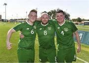 19 March 2019; Team Ireland's James Hunter, left, a member of Mallow Utd, from Mallow, Co. Cork, Team Ireland's Stephen Lee, centre, a member of the Cabra Lions Special Olympics Club, from Dublin 7, Co. Dublin, and Team Ireland's William McGrath, a member of Waterford SO Clubs, from Kilmacthomas, Co. Waterford, celebrate after beating SO Estonia 7-2 to take the Bronze medal place on Day Five of the 2019 Special Olympics World Games in Zayed Sports City, Airport Road, Abu Dhabi, United Arab Emirates. Photo by Ray McManus/Sportsfile