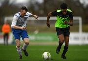19 March 2019; Eric Abulu of TU Dublin Blanchardstown in action against Dan Ridge of TU Dublin Tallaght during the RUSTLERS Third Level CUFL Men's Division One Final match between Technological University Blanchardstown and Technological University Tallaght at Athlone Town Stadium in Athlone, Co. Westmeath. Photo by Harry Murphy/Sportsfile