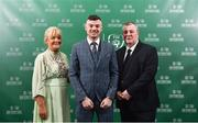 17 March 2019; Darragh Reynor of Maynooth University Town, centre, with mother Liz and father John arrive prior to the Three FAI International Awards at RTE Studios in Donnybrook, Dublin. Photo by Seb Daly/Sportsfile