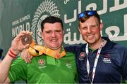 20 March 2019; Team Ireland's William McGrath, a member of Waterford SO Clubs, from Kilmacthomas, Co. Waterford, and Coach Emmet O'Toole, from Waterford,  after the presentation to Team Ireland seven a-side squad who collected their Bronze Medals on Day Six of the 2019 Special Olympics World Games in Zayed Sports City, Airport Road, Abu Dhabi, United Arab Emirates. Photo by Ray McManus/Sportsfile