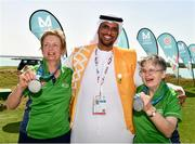 20 March 2019; Special Olympics Volunteer Mansoor Ali Aljaberi with Team Ireland's Mairead Moroney, a member of the Ennis SOGC, from Ennis, Co. Clare, who has the distinction of being the oldest athlete at the Games, and her Alternate Shot Team Play Partner Jean Molony, left, after they had collected their Silver Medal in the Level 2 - Unified Alternate Shot Team Play Competition on Day Six of the 2019 Special Olympics World Games in Yas Links, Yas Island, Abu Dhabi, United Arab Emirates  Photo by Ray McManus/Sportsfile