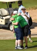 20 March 2019; Team Ireland's Mark Claffey, a member of the Blackrock Flyers Special Olympics Club, from Blackrock, Co. Dublin, hugs his brother Aidan after winning a Gold Medal in the Level 4 - Individual Stroke Play Competition on Day Six of the 2019 Special Olympics World Games in Yas Links, Yas Island, Abu Dhabi, United Arab Emirates  Photo by Ray McManus/Sportsfile