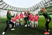 21 March 2019; Media personality and mum of three Yvonne Connolly and her daughter Ali Keating officially kicked off the FAI Aviva Soccer Sisters Easter Football Festival this morning at Aviva Stadium alongside Ireland international players Niamh Farrelly and Isibeal Atkinson. This year's programme has been revamped, now offering FREE camps over the Easter period (15th – 26th April) for girls aged between 6 – 14 years old. Over 6,000 girls from clubs around the country are expected to take part. See soccersisters.ie or #SafeToDream for details. In attendance at the launch are Republic of Ireland internationals Niamh Farrelly, left, and Isibeal Atkinson, along with Yvonne Connolly and her duaghter Ali Keating, aged 13, centre, and attendees at the Aviva Stadium in Dublin. Photo by Sam Barnes/Sportsfile