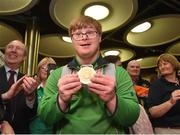 22 March 2019; Team Ireland's Mark Claffey, a member of the Blackrock Flyers Special Olympics Club, from Blackrock, Co. Dublin, with his gold medal for Golf on his return from the 2019 World Summer Games Abu Dhabi at Dublin Airport in Dublin. Photo by Matt Browne/Sportsfile