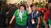 22 March 2019; Team Ireland's Chelsea Phillips, a member of the Roscommon SO Club, from Castlerea, Co. Roscommon, and Swimming coach Chaperone Ester King, right, lead out Team Ireland athletes as they arrive home from the 2019 World Summer Games Abu Dhabi at Dublin Airport in Dublin. Photo by Ray McManus/Sportsfile