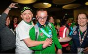 22 March 2019; Team Ireland's Oisin Gilmartin, a member of the Palmerstown Wildcats Special Olympics Club, from Dublin 20, Co. Dublin,  is welcomed home by his Dad, Sean, left, and Basketball Head Coach Lorraine Bracken on his return from the 2019 World Summer Games Abu Dhabi at Dublin Airport in Dublin Photo by Ray McManus/Sportsfile