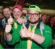 22 March 2019; Team Ireland's Omer Teko, a member of United Warriors Special Olympics Club, from Dublin 12, Co. Dublin, and left, Team Ireland's William McGrath, a member of Waterford SO Clubs, from Kilmacthomas, Co. Waterford, on their return from the 2019 World Summer Games Abu Dhabi at Dublin Airport in Dublin Photo by Ray McManus/Sportsfile