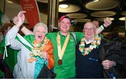 22 March 2019; Team Ireland's William McGrath, a member of Waterford SO Clubs, from Kilmacthomas, Co. Waterford, with his mam Breda and dad Tom on his return from the 2019 World Summer Games Abu Dhabi at Dublin Airport in Dublin Photo by Ray McManus/Sportsfile