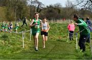23 March 2019; Myles Hewlett of CBS New Ross, Co.Waterford, Ireland, is urged on by team manager Fintan Reilly whilst competing in the Junior Boys event during the SIAB Schools Cross Country International at Santry Demense in Santry, Dublin. Photo by Sam Barnes/Sportsfile