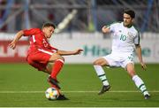 23 March 2019; Tjay De Barr of Gibraltar in action against Robbie Brady of Republic of Ireland during the UEFA EURO2020 Qualifier Group D match between Gibraltar and Republic of Ireland at Victoria Stadium in Gibraltar. Photo by Stephen McCarthy/Sportsfile