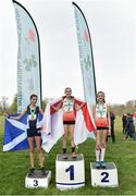23 March 2019; Junior girls indiviudal medallists, from left, Katie Johnson of Preston Lodge High School, Prestonpans, Scotland, bronze, Holly  Weedall of Weaverham High School, Cheshire, England, gold and Kiya Dee of Farmors School, Gloucestershire ,England, silver, during the SIAB Schools Cross Country International at Santry Demense in Santry, Dublin. Photo by Sam Barnes/Sportsfile