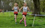 23 March 2019; Olivia  Breed of Sevenoaks Prep School, Kent, England, right, and Annie Naylor of Notre Dame High School, South Yorkshire, England, competing in the Junior Girls event during the SIAB Schools Cross Country International at Santry Demense in Santry, Dublin. Photo by Sam Barnes/Sportsfile