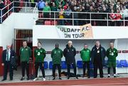 23 March 2019; The Republic of Ireland bench, from left, Bobby Ward, head of team security, Alan Kelly, goalkeeping coach, Robbie Keane, assistant coach, Terry Connor, assistant coach, manager Mick McCarthy, Dr Alan Byrne, team doctor, technical advisor Dave Bowman and Andy Liddle, fitness coach, during the national anthem prior to the UEFA EURO2020 Qualifier Group D match between Gibraltar and Republic of Ireland at Victoria Stadium in Gibraltar. Photo by Stephen McCarthy/Sportsfile