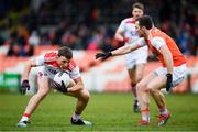 24 March 2019; Mark Collins of Cork in action against Brendan Donaghy of Armagh during the Allianz Football League Division 2 Round 7 match between Armagh and Cork at the Athletic Grounds in Armagh. Photo by Ramsey Cardy/Sportsfile