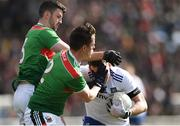 24 March 2019; Conor McManus of Monaghan in action against Brendan Harrison, left, and Stephen Coen of Mayo during the Allianz Football League Division 1 Round 7 match between Mayo and Monaghan at Elverys MacHale Park in Castlebar, Mayo. Photo by Piaras Ó Mídheach/Sportsfile
