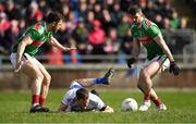 24 March 2019; Conor McManus of Monaghan after being tackled by Brendan Harrison of Mayo, right, as Chris Barrett looks on during the Allianz Football League Division 1 Round 7 match between Mayo and Monaghan at Elverys MacHale Park in Castlebar, Mayo. Photo by Piaras Ó Mídheach/Sportsfile