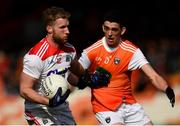 24 March 2019; Ruairi Deane of Cork in action against Rory Grugan of Armagh during the Allianz Football League Division 2 Round 7 match between Armagh and Cork at the Athletic Grounds in Armagh. Photo by Ramsey Cardy/Sportsfile