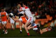 24 March 2019; Brendan Donaghy of Armagh in action against Conor Dennehy of Cork during the Allianz Football League Division 2 Round 7 match between Armagh and Cork at the Athletic Grounds in Armagh. Photo by Ramsey Cardy/Sportsfile