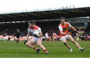 24 March 2019; Brian Hurley of Cork in action against Paul Hughes of Armagh during the Allianz Football League Division 2 Round 7 match between Armagh and Cork at the Athletic Grounds in Armagh. Photo by Ramsey Cardy/Sportsfile