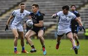 24 March 2019; Con O'Callaghan of Dublin in action against Conor Moynagh and Killian Clarke, left, of Cavan during the Allianz Football League Division 1 Round 7 match between Cavan and Dublin at Kingspan Breffni in Cavan. Photo by Ray McManus/Sportsfile