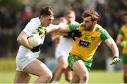 24 March 2019; Neil Flynn of Kildare in action against Stephen McMenamin of Donegal  during the Allianz Football League Division 2 Round 7 match between Donegal and Kildare at Fr. Tierney Park in Ballyshannon, Donegal. Photo by Oliver McVeigh/Sportsfile