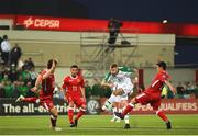 23 March 2019; James McClean of Republic of Ireland takes a shot under pressure from Jayce Olivero, left, an Anthony Bardon of Gibraltar, right, during the UEFA EURO2020 Qualifier Group D match between Gibraltar and Republic of Ireland at Victoria Stadium in Gibraltar. Photo by Seb Daly/Sportsfile